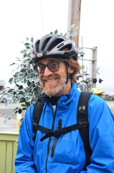 "John Schlatter lives near Firdale Village and regularly commutes by bicycle to his job in Mukilteo, a 10.7 mile ride. ""I'm committed to riding my bike to work every day in May,"" he said. ""I keep it up in winter, but often have to cut back to 2-3 days per week depending on weather."""