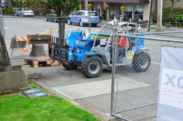 Free from the old structure at last, the Edmonds School Bell takes its first step toward the steel shop where it will be refurbished and attached to a new artistic steel holding structure.