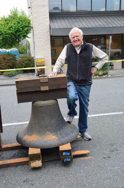 Retired steel fabricator and longtime friend and supporter of the Museum, John Osberg stands next to the bell.  Osberg's generosity is funding the entire project of removing, refurbishing and reinstalling the bell.