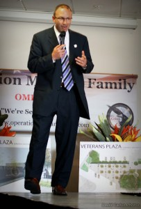 Operation Military Family's Mike Schindler welcomes attendees to the event.