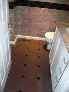 Purple Vermont slate floor with Absolute black granite drops on corners -- bathroom floor.