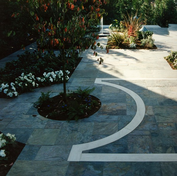 """Rajah Ashlar pattern """"Multi-color"""" slate with Claire limestone slab outdoor courtyard."""