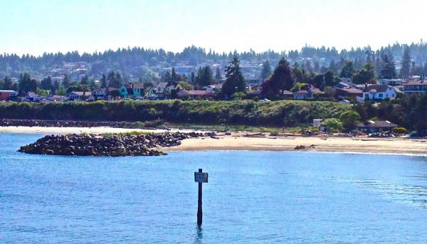 Janice Warren took these views of Edmonds and a ship passing through, while riding the Edmonds-Kingston ferry Thursday.