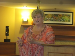 Vicci Hilty, executive director of Domestic Violence Services of Snohomish County, speaks about elder abuse at the Thursday, June 25th meeting of the Lynnwood Chamber of Commerce.
