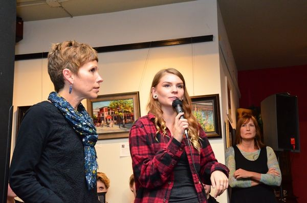 Brieaunna Dacruz speaks to the group about the challenges of the writing program as program founders Ingrid Ricks and Marjie Bowker look on.