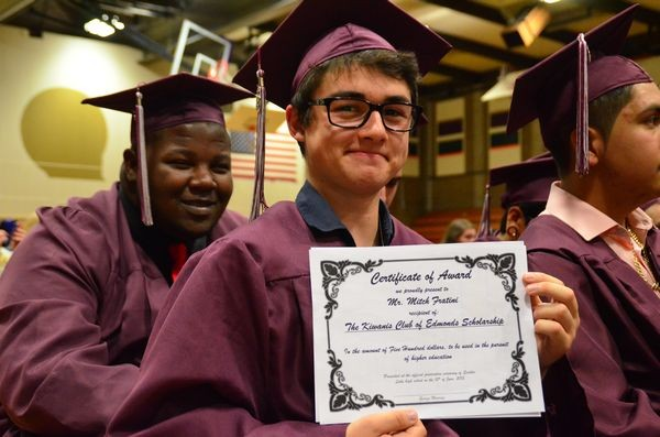 A number of scholarships were presented from the Edmonds School District Foundation, the local Rotary and Kiwanis Clubs, and others.  Here Mitch Fratini hold up his certificate for a $1,500 scholarship presented by the Edmonds Kiwanis Club.