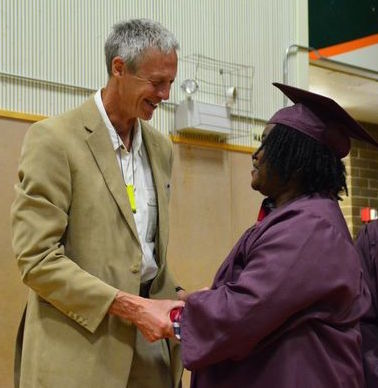 Chris Brown, a 20-year faculty member, congratulated each student as they walked up to receive their diplomas.