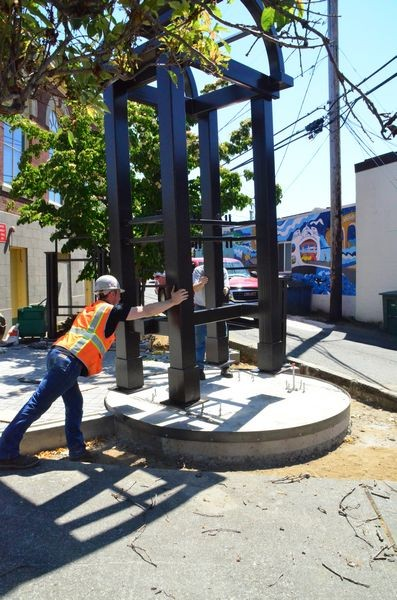 Crews from Wilcox Construction of Edmonds move the new bell tower into position in the new Edmonds Museum Plaza.  The new steel tower weighs five tons, and replaces the old wooden and concrete structure made of railroad ties and jersey barriers.