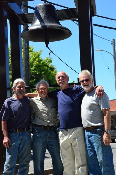Standing in front of the new bell tower are Neil Harrigan of Wilcox Construction; John Osberg, whose generosity made the bell tower possible; project designer Clayton Moss and Mark Schrader of Wilcox Construction.
