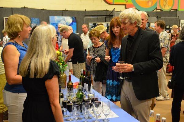 Edmonds sculptor David Varnau stops for a glass of wine