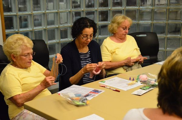The needles fly as group members turn skeins of yarn into hats sized to fit kids from newborn to 12 years. The hats are distributed by Providence Hospital to foster and at-risk kids in Snohomish County.