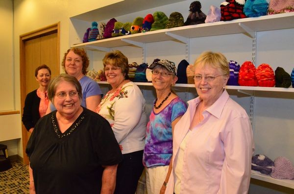 Group members stand in front of some of the hats about to be donated to help foster and at-risk kids. L to R Judy Glaza, Lauren Heerschap, Marian Smith, Cindy Francis, Janice Carr and Catherine Alexander.