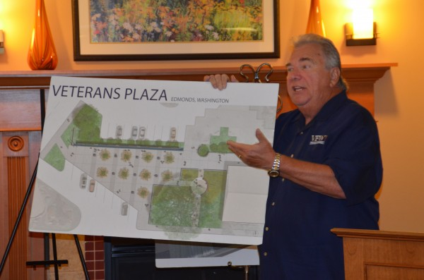 """Edmonds Veterans Plaza Chair Ron Clyborne, a Marine Corps Vietnam veteran and Edmonds real estate agent, provided an update on the plaza project for those attending Wednesday's Edmonds Chamber of Commerce networking breakfast. The goal is to raise $450,000 to build a tribute to veterans outside the Public Safety Complex plaza. It will include a polished stone wall with individual areas for each of the five services, each separated by a series of miniature waterfalls. There will be matching stone seating pedestals and a small memorial garden honoring those who paid the ultimate sacrifice. """"This is going to be an incredible addition to the community,"""" Clyborne said. """"It's going to be really beautiful."""" Learn more at edmondsveteransplaza.com."""