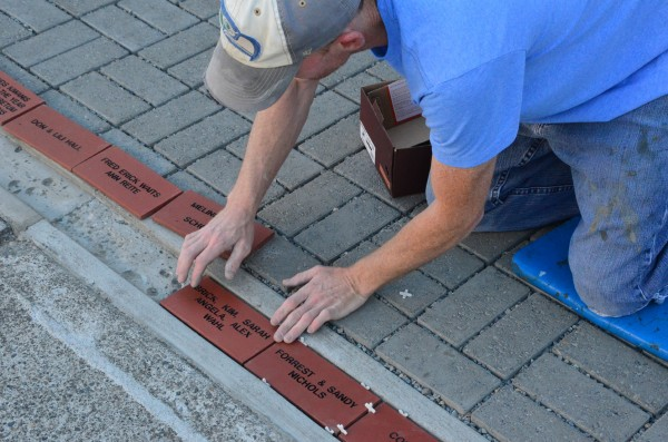 "With the arrival of the first shipment of personalized paving tiles, crews from Edmonds' Reliable Floors have begun setting them in the new Edmonds Historical Museum Plaza patio in time for the Plaza's formal dedication to take place during the Edmonds 125th Anniversary celebration on August 11.    ""This is the 'first wave' of tiles,"" said Museum Board Member and official ""Tile Czar"" Ann Wood. ""We're still awaiting arrival of orders placed later, so not everyone will see their tile on August 11.  We'll continue to install tiles as we receive them."" According to Wood, there's still time to order your personalized tile. More information and ordering instructions are on the Edmonds Historical Museum website , or call the Museum at 425-774-0900. --"