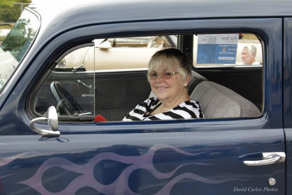 Jackie King sits in her 1947 Plymouth 2-Door Deluxe Coupe.