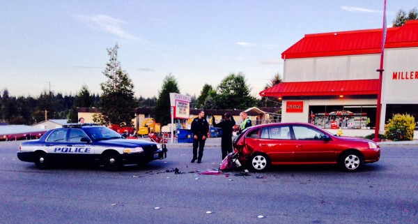 """Edmonds police responded at 8 p.m. Thursday evening to a non-injury accident at 22901 Highway 99.  According to eyewitness Wayne Snider, a long-haul driver for Jay Waters, Inc. trucking company, the driver of the red KIA """"had a tire malfunction"""" which sent him into the center lane.  Moments later the KIA was rear-ended by the driver of a silver Dodge Neon.   Mr. Snider, a Texas native, noted that in his 30 years in the trucking industry he has seen """"all kinds of fender benders"""" and is happy to looking forward to celebrating his retirement in the coming months."""