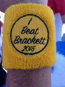 """The wristband given to those runners who actually finished ahead of """"George Brackett"""" in Saturday's race. (Photo by Larry Vogel)"""