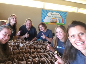 A food kit packing event at Insurance Services Group in May 2015.