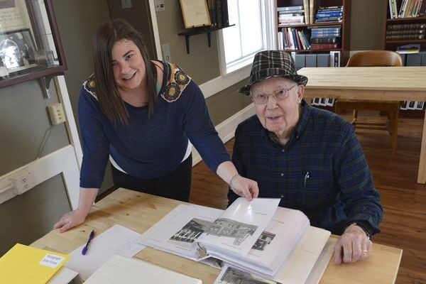 Newly-named Edmonds Historical Museum Director Caitlin Kelly is always available to share her knowledge and help visitors interested in local history.  Here she assists Clarence Caspers with historical research. (Photo by Bob Sears)