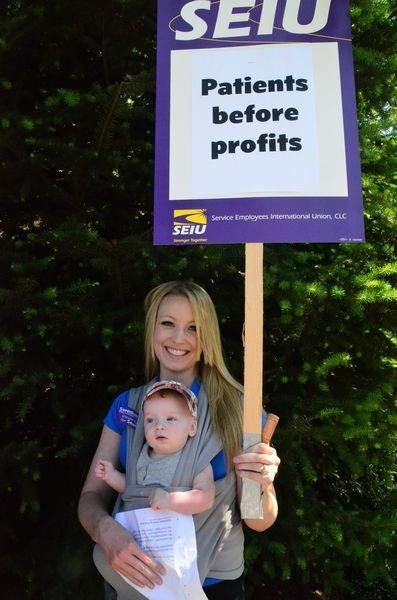 """Jessica Reeder and son Wyatt drove in from their home in Arlington on Reeder's day off to attend the event.  An ER nurse at Swedish/Edmonds, Jessica says they need more permanent staff.  """"We're short many nights,"""" she said."""