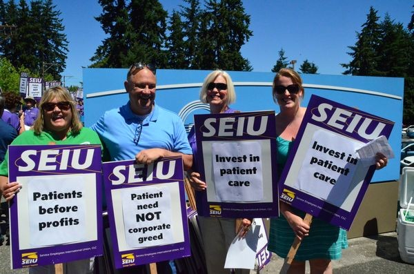 Joining the picketers were Edmonds City Council President Adrienne Fraley-Monillas, Snohomish County Councilmember Brian Sullivan, shown here with Swedish/Edmonds nurses Diane Moller and Ericka Perry.