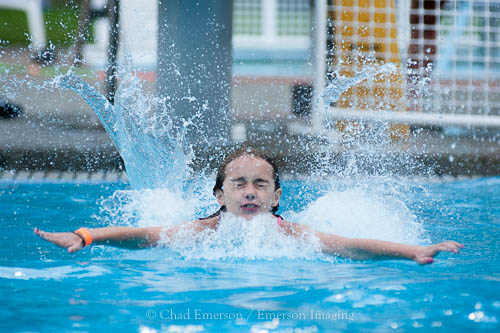A swimmer makes a splash during the belly flop and cannon ball contest at Yost Pool Sunday. (Photo by Chad Emerson)