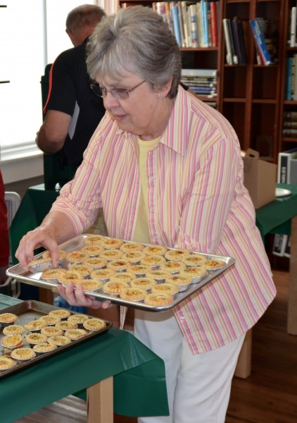 Museum volunteer Wanda Pederson serves quiche.
