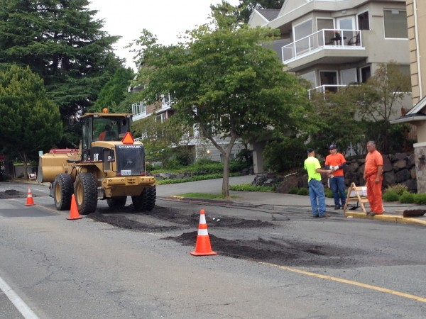 Crews at work Wednesday patching and resurfacing Dayton Street between 5th and 6th Avenues. One lane is closed, so look for delays if you plan to drive this route. (Photos by Larry Vogel)