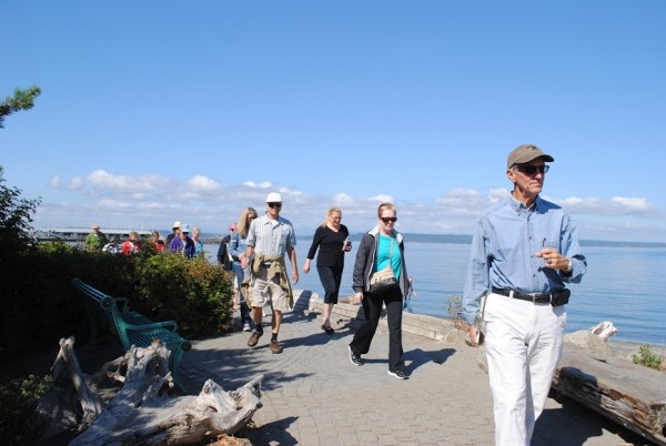 Vogel leads a group of 15 Edmonds Senior Center members on the Edmonds waterfront.