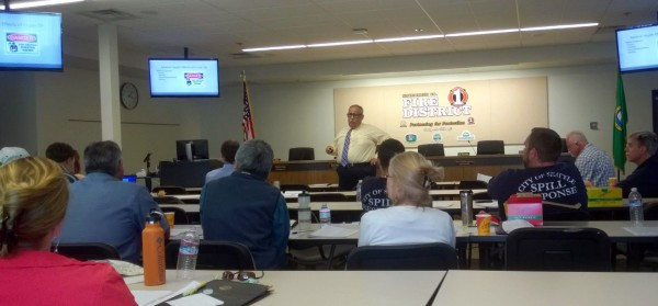 John Malool, a New Jersey hazardous materials chief and safety specialist, teaches a class on oil-train risks and preparedness at Snohomish County Fire District 1. Five senior officers from Fire District 1 participated in the class to learn about the characteristics and response steps associated with crude oil carried by rail through the Puget Sound region.