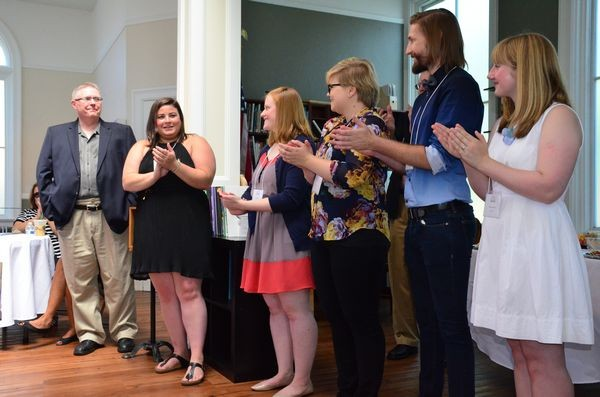 Museum Director Caitlin Kelley with University of Washington graduate students and their professor, Wilson O'Donnell, left.