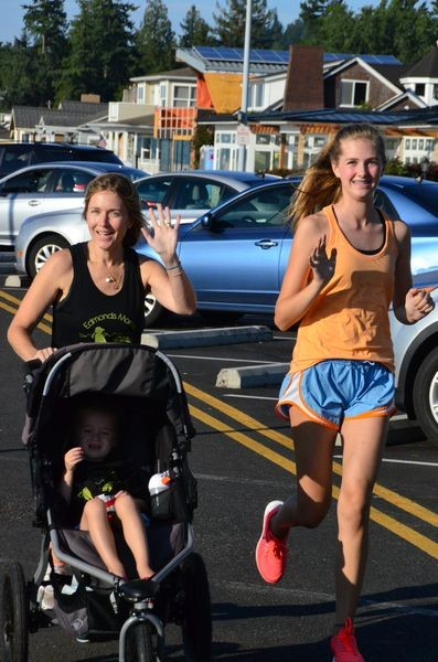 Runners take advantage of Sunset Avenue's paved pathway.
