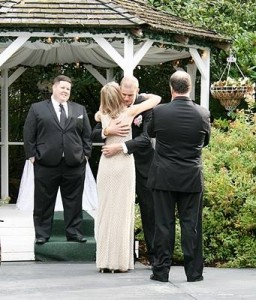 Giving Ian a hug as the ceremony begins. (Photo by Patricia Mackey)