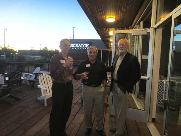 Brigid's Bottle Shop hosted the Edmonds Art Studio Tour Tenth Anniversary party Wednesday night. Among those enjoying the festivities, from left: xxx, Rock Peterson and Edmonds Mayor Dave Earling.