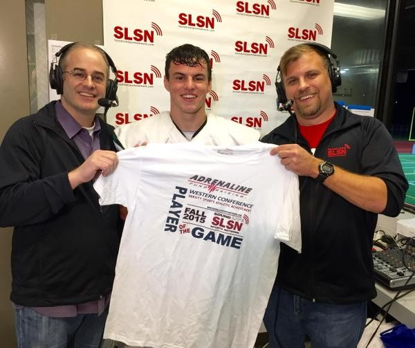 Issac Jackson receives the Adrenaline Sports Player of the Game award from Sound Live Sports Network broadcasters Keith Nealey and Steve Willits.