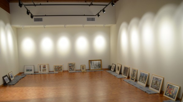 Paintings await hanging for the inaugural Cascadia Art Museum exhibit.