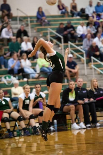 Amanda Paavola keeps an eye on the ball as she serves.