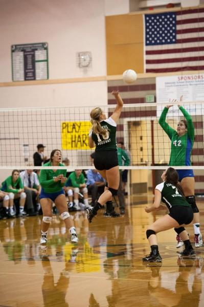 Missy Peterson blocks the ball.