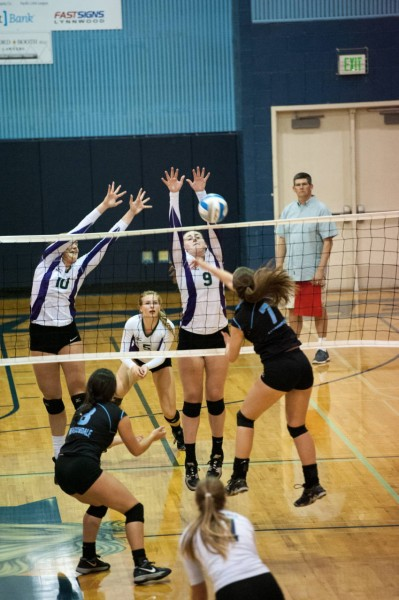 Emily Carroll (Meadowdale) tries to get the ball past Maddie Tudor (Edmonds Woodway).