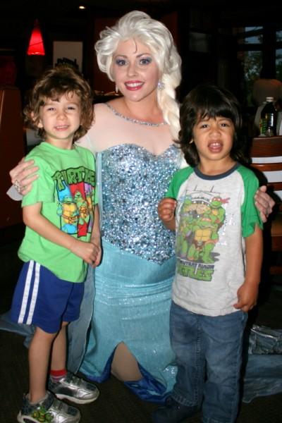Brody Jimenez and Noah Gamble (right) of Lynnwood enjoy visiting with Elsa.