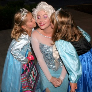 Elsa gets kisses from Evie and Ella Brotherthon (right).