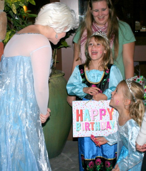 Ella, 7, and Evie Brotherthon, 7, (right) of Edmonds are excited to see Elsa from Disney's Frozen during Holly House's fundraiser Wednesday evening at Macaroni Grill at Alderwood Mall in Lynnwood. (Photos by David Pan)