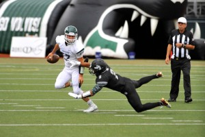 Edmonds-Woodway's Isaac Jackson tries to avoid a Jackson defending during Friday non-conference game at Everett Memorial Stadium. (Photos by Karl Swenson)