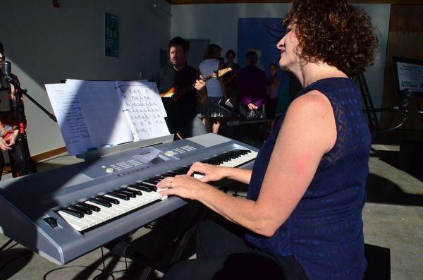 Pianist Debbie DeMiero provides entertainment.