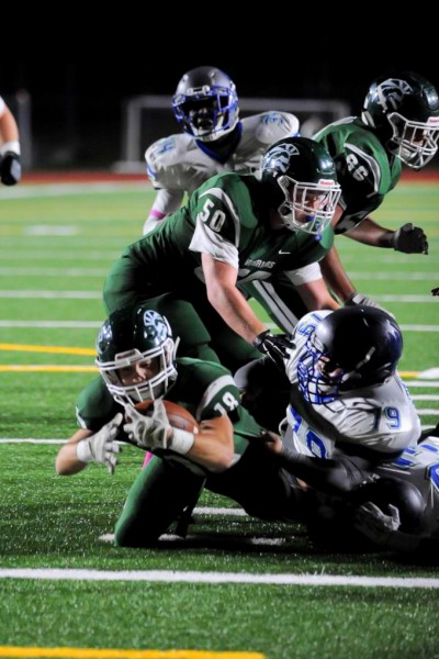 Edmonds-Woodway's Graydon Heron dives in for the touchdown during a Wesco 3A South game against Shorewood Friday at Edmonds Stadium. (Photos by Karl Swenson)