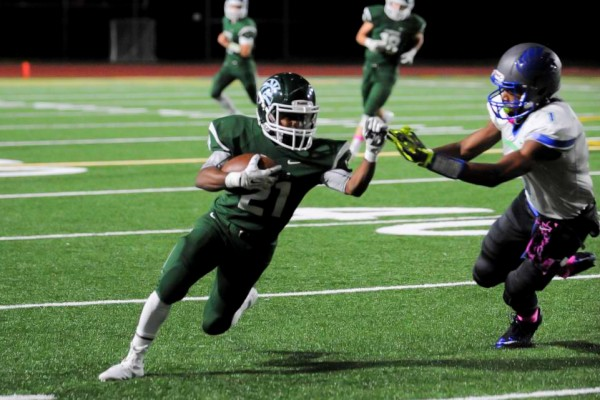 Edmonds-Woodway's Jalen Nash tries to run by Shorewood's Ronnie Gary.