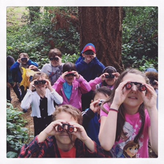 """Edmonds Heights K-12 science teacher Erin Zackey sent along a photo of students in her Froggy Holler class out birding last week. """"The class has fun exploring the woods surrounding our school to learn more about our local ecosystems,"""" she said."""