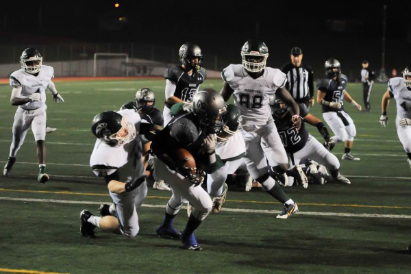 Zander Hall-Spicuzza and Logan Lambert force down Dexter Carter in the end zone.