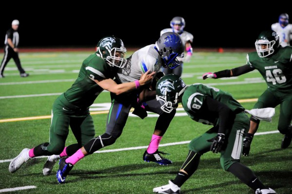 The Warrior defense, including converges on Shorewood's Ronnie Gary.