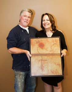 """Dragonfire resident artist Michael Cadieux with Marilla Sargent holding """"Determined"""" which was among the pieces made available for the """"ECA 2015 Red Carpet Gala and Auction""""."""